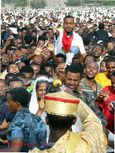 Deacon baptising the crowd at the Timkat ceremony in Addis Abeba