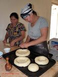 Women baking traditional bread