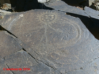 Tamgaly petroglyphs: a sun-headed person